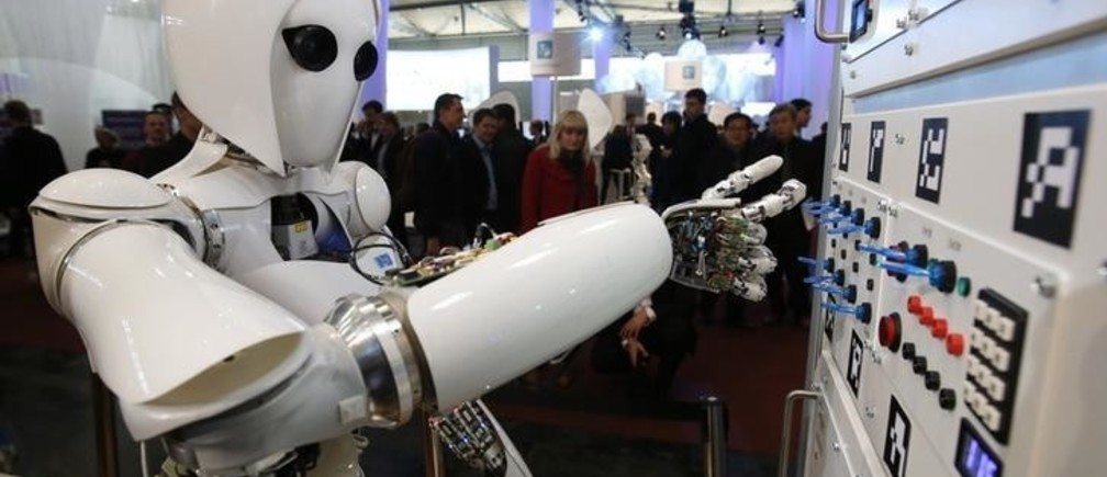 The humanoid robot AILA (artificial intelligence lightweight android) operates a switchboard during a demonstration by the German research centre for artificial intelligence at the CeBit computer fair in Hanover March, 5, 2013. The biggest fair of its kind open its doors to the public on March 5 and will run till March 9, 2013.  REUTERS/Fabrizio Bensch (GERMANY - Tags: BUSINESS SCIENCE TECHNOLOGY)