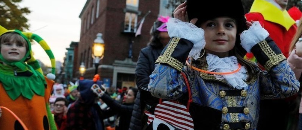 Children in costume wait for the Charlestown Halloween Parade in Boston, Massachusetts, U.S., October 31, 2018.   REUTERS/Brian Snyder