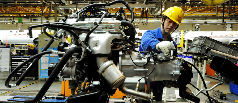 An employee works on an assembly line producing automobiles at a factory in Qingdao, Shandong Province, China, March 1, 2016. Activity in China's manufacturing sector shrank more sharply than expected in February, surveys showed on Tuesday, prompting smaller companies to shed workers at the fastest pace in seven years and suggesting Beijing will have to ramp up stimulus to avoid a deeper economic slowdown. REUTERS/Stringer ATTENTION EDITORS - THIS PICTURE WAS PROVIDED BY A THIRD PARTY. THIS PICTURE IS DISTRIBUTED EXACTLY AS RECEIVED BY REUTERS, AS A SERVICE TO CLIENTS. CHINA OUT. NO COMMERCIAL OR EDITORIAL SALES IN CHINA.       TPX IMAGES OF THE DAY      - GF10000328892