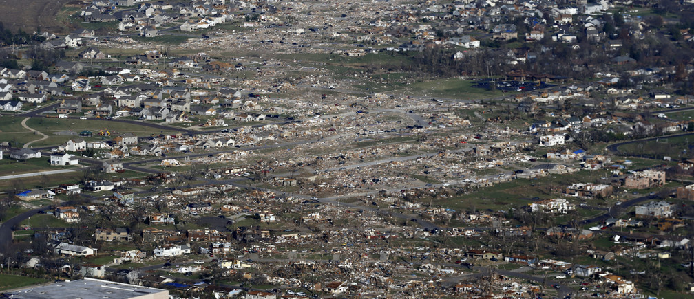 An aerial view shows the path of destruction caused by a tornado that touched down in Washington, Illinois, November 18, 2013. A fast-moving storm system triggered multiple tornadoes on Sunday that killed at least six people and flattened large parts of a town in Illinois as it tore across the Midwest, authorities said. REUTERS/Jim Young  (UNITED STATES - Tags: DISASTER ENVIRONMENT TPX IMAGES OF THE DAY) - GM1E9BJ0EK201