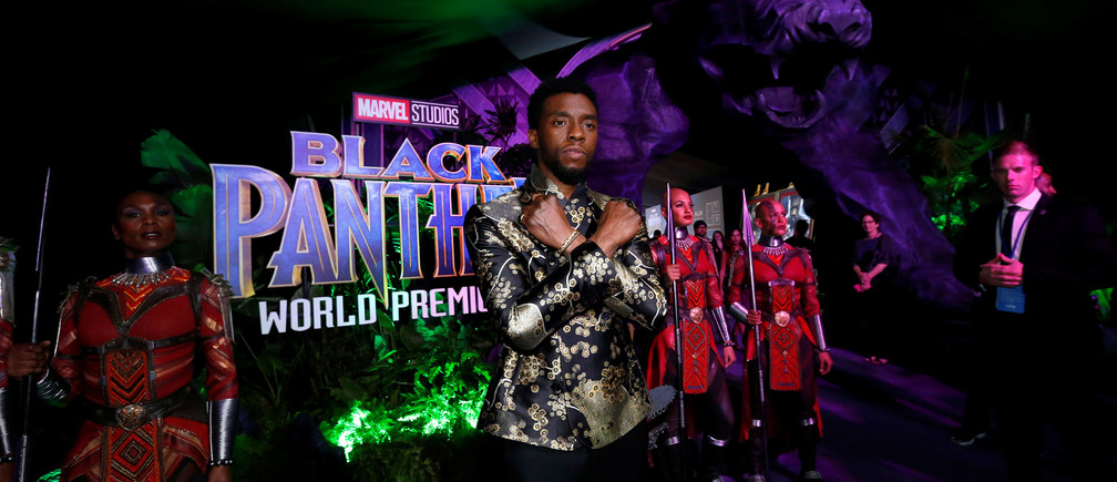 Black Panther actor Chadwick Boseman poses Wakanda-style at the film's premiere.