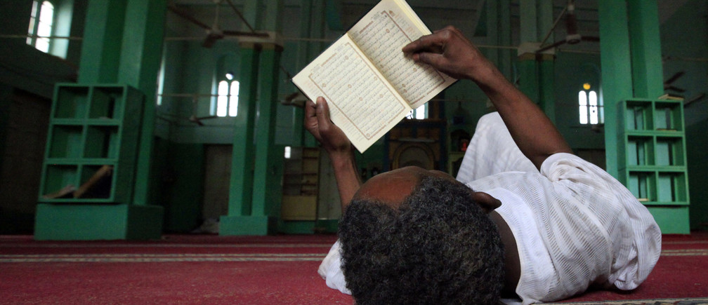 A man reads the Koran on the first Friday of Ramadan in a mosque at Umdowan Ban village outside Khartoum August 5, 2011. REUTERS/Mohamed Nureldin Abdallah (SUDAN - Tags: RELIGION IMAGES OF THE DAY) - GM1E7860FV201
