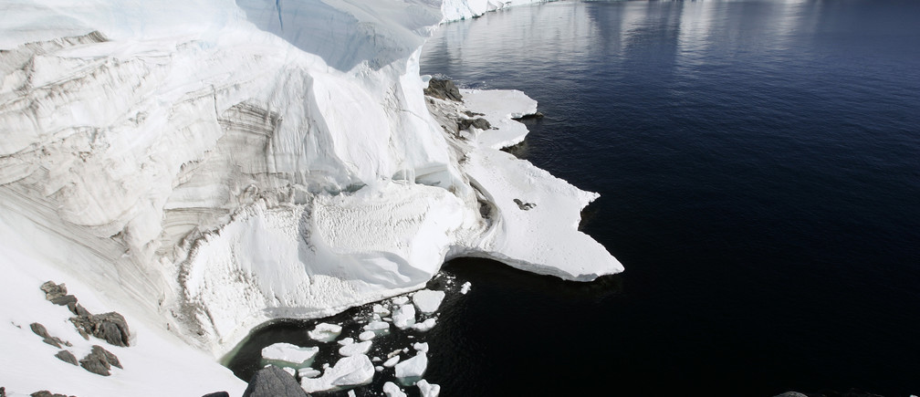 """Melting ice shows through at a cliff face at Landsend, on the coast of Cape Denison in Antarctica December 12, 2009. Russia and the Ukraine on November 1, 2013 again scuttled plans to create the world's largest ocean sanctuary in Antarctica, pristine waters rich in energy and species such as whales, penguins and vast stocks of fish, an environmentalist group said. The Commission for the Conservation of Antarctic Marine Living Resources wound up a week-long meeting in Hobart, Australia, considering proposals for two """"marine protected areas"""" aimed at conserving the ocean wilderness from fishing, drilling for oil and other industrial interests. Picture taken December 12, 2009. To match story ANTARCTIC-ENVIRONMENT/ REUTERS/Pauline Askin  (ANTARCTICA - Tags: ENVIRONMENT POLITICS) - RTX14WB4"""