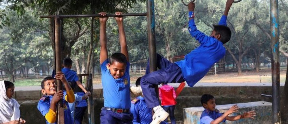 Children in school uniforms play at a park in Dhaka, Bangladesh, December 18, 2019. REUTERS/Mohammad Ponir Hossain