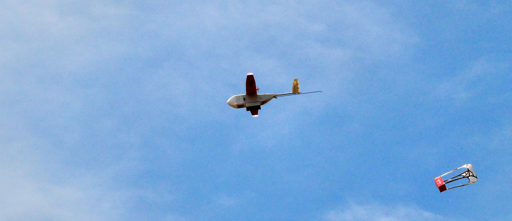 A drone drops its first blood delivery in the compound of Kabgayi hospital south of Rwanda capital Kigali where Zipline, a California-based robotics company delivered their first blood to patients using a drone October 13, 2016. Picture taken October 13, 2016.