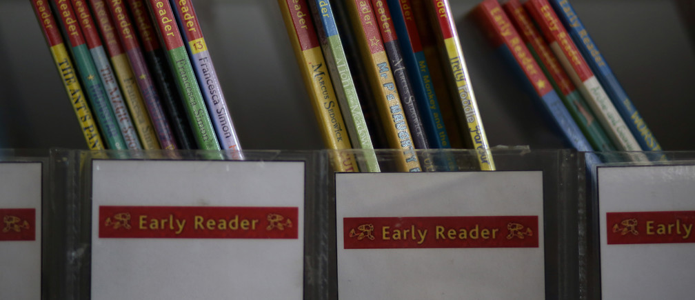 Children's reading books are seen on a shelf inside Widnes Library in Widnes, Britain September 12, 2018. REUTERS/Phil Noble - RC1FB98571B0