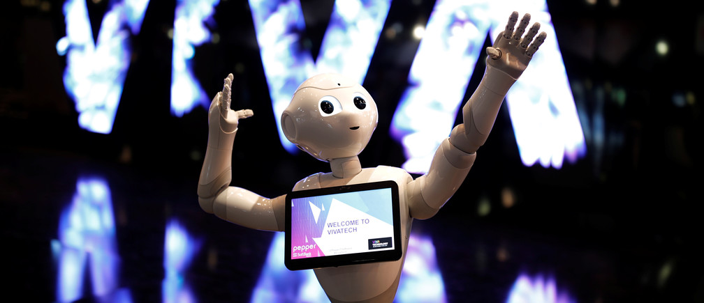A 'Pepper' humanoid robot, manufactured by SoftBank Group Corp., stands at the Viva Technology conference in Paris, France, June 15, 2017. REUTERS/Benoit Tessier - RTS178N6