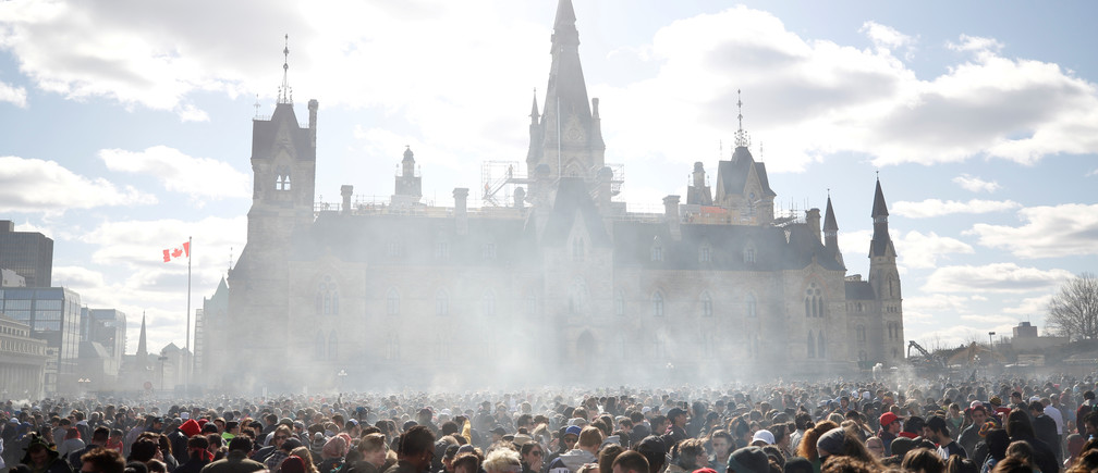 Smoke rises during the annual 4/20 marijuana rally on Parliament Hill in Ottawa, Ontario, Canada, April 20, 2018. REUTERS/Chris Wattie     TPX IMAGES OF THE DAY - RC1756F8D8C0