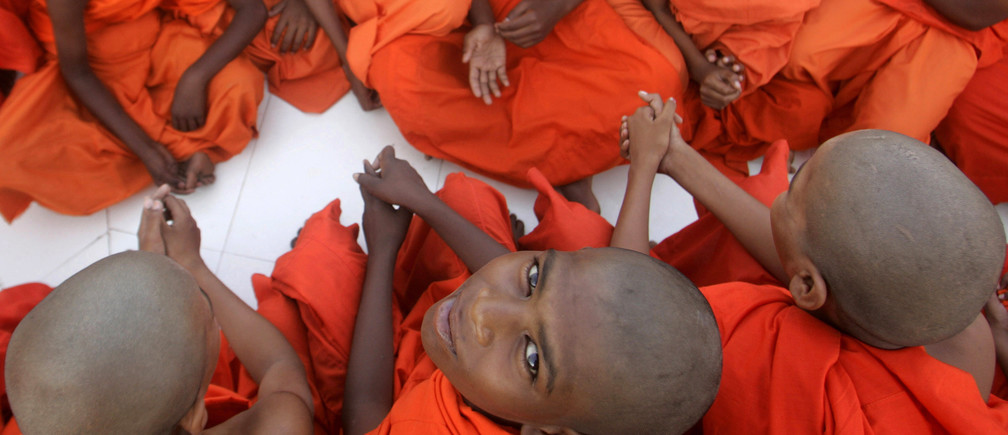 Buddhist monks attend a special prayer to mark the Buddha Jayanti in the central Indian city of Bhopal May 27, 2010. Buddha Jayanti, or birth anniversary, commemorates the birth and enlightenment of Buddha and his attainment of Nirvana. REUTERS/Raj Patidar (INDIA - Tags: ANNIVERSARY SOCIETY RELIGION IMAGES OF THE DAY) - GM1E65R1EBV01