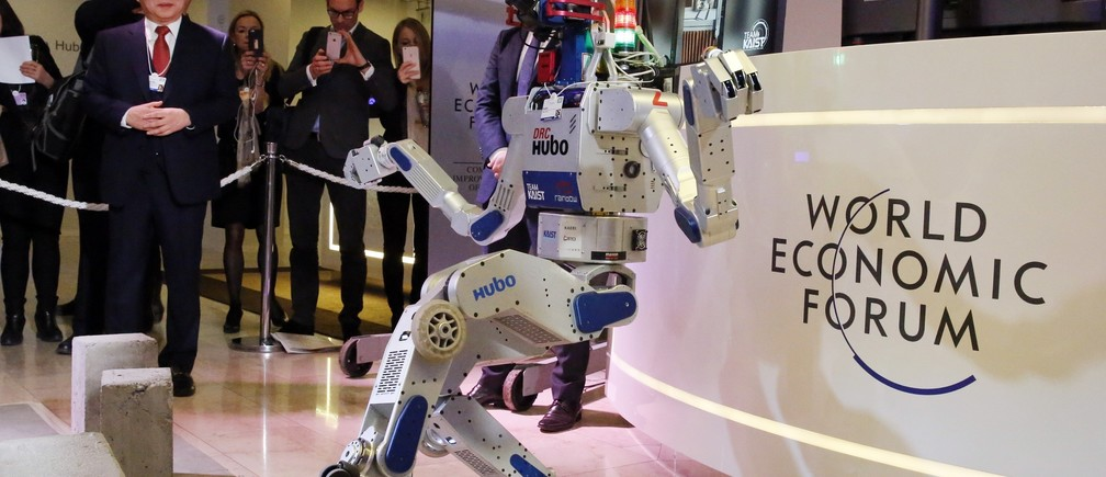 HUBO, a multifunctional walking humanoid robot performs a demonstration of its capacities next to its developer Oh Jun-Ho, Professor at the Korea Advanced Institute of Science and Technology (KAIST) during the annual meeting of the World Economic Forum (WEF) in Davos, Switzerland January 20, 2016.