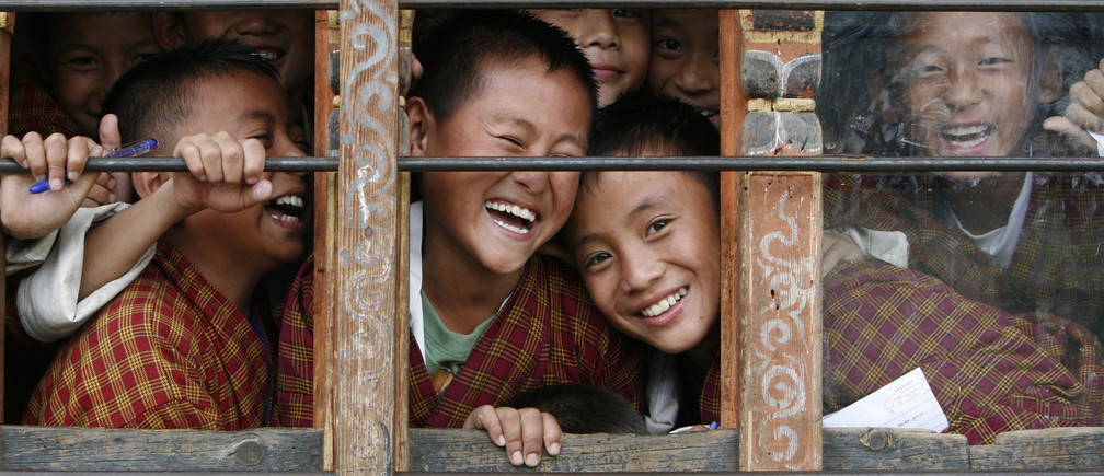 School children react to the camera through the window of their classroom in a school in Thimphu September 22, 2010. REUTERS/Singye Wangchuk (BHUTAN - Tags: EDUCATION SOCIETY)FOR BEST QUALITY IMAGE SEE: GM1E74D1J0N01 - GM1E69M1PQ902