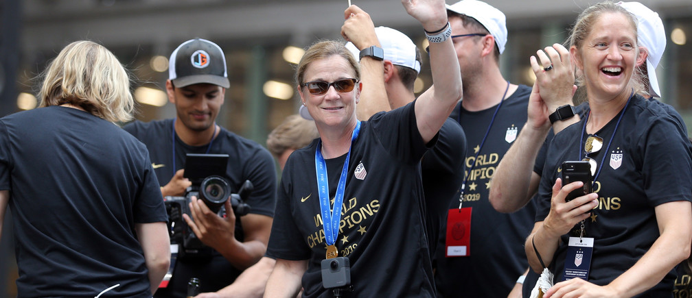 Jul 10, 2019; New York, NY, USA; United States women's national team head coach Jill Ellis waves from her float during the ticker-tape parade for the United States women's national soccer team down the canyon of heroes in New York City. Mandatory Credit: Brad Penner-USA TODAY Sports - 13024922