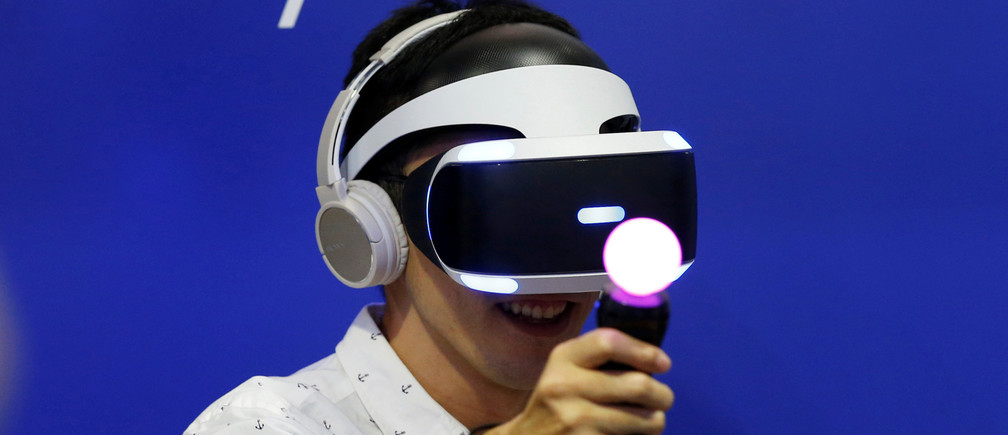 A man plays a video game with Sony's PlayStation VR headset at Tokyo Game Show 2016 in Makuhari, east of Tokyo, Japan, September 15, 2016.