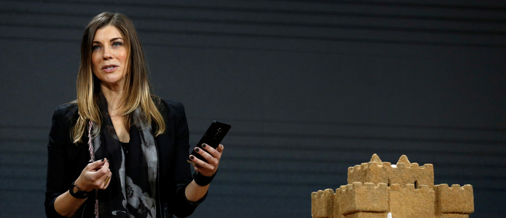 """Megan Saunders, Microsoft general manager of HoloLens and other emergent technologies uses a mobile phone to scan a sand castle object into Microsoft's new """"Paint 3D"""" at a live Microsoft event in the Manhattan borough of New York City, October 26, 2016. REUTERS/Lucas Jackson - RTX2QJKO"""