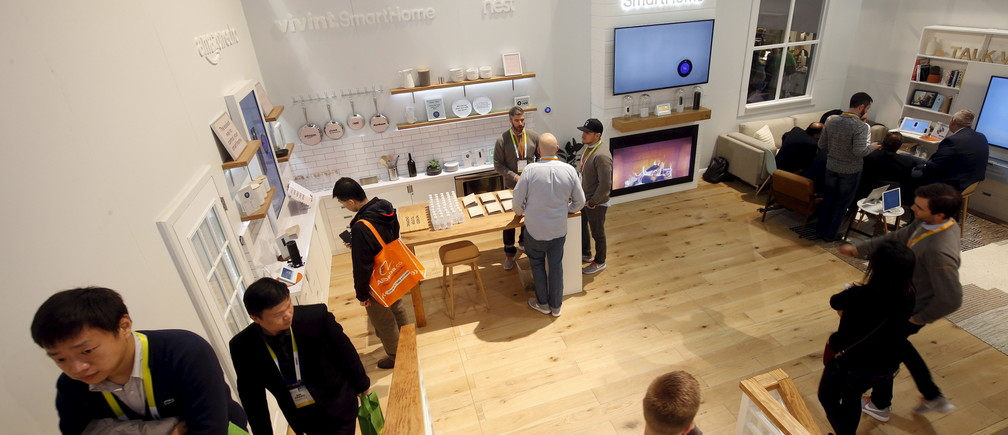 Attendees tour a Vivint Smart Home during the 2016 CES trade show in Las Vegas, Nevada January 8, 2016. One of the new products is the Vivint Ping, a two-way indoor camera. With the Ping, people in the house can contact the homeowner's smartphone or tablet at the touch of a button or the homeowner can connect to the Ping via their mobile device to check on the home remotely.