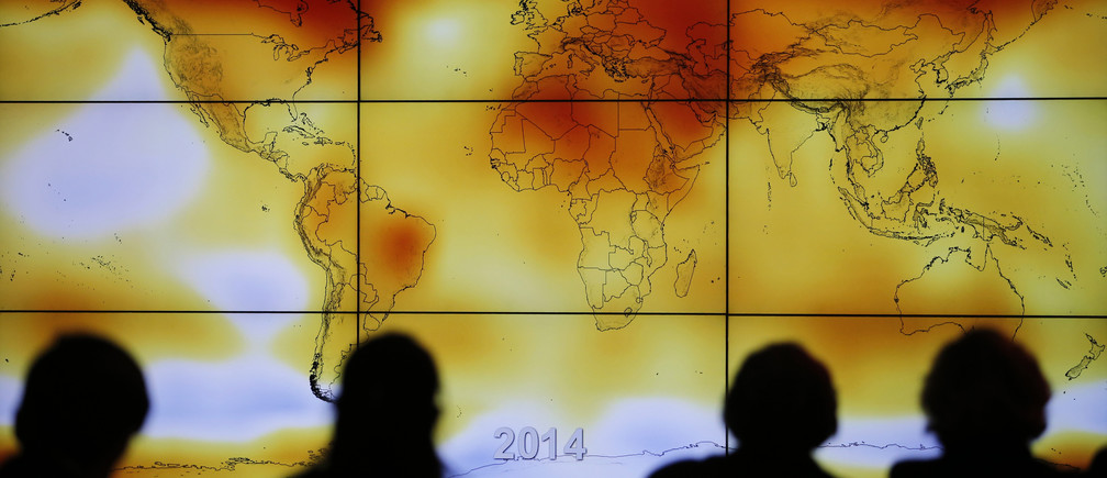 Participants are seen in silhouette as they look at a screen showing a world map with climate anomalies during the World Climate Change Conference 2015 (COP21) at Le Bourget, near Paris, France, December 8, 2015.  REUTERS/Stephane Mahe      TPX IMAGES OF THE DAY  - LR1EBC80XNCRN