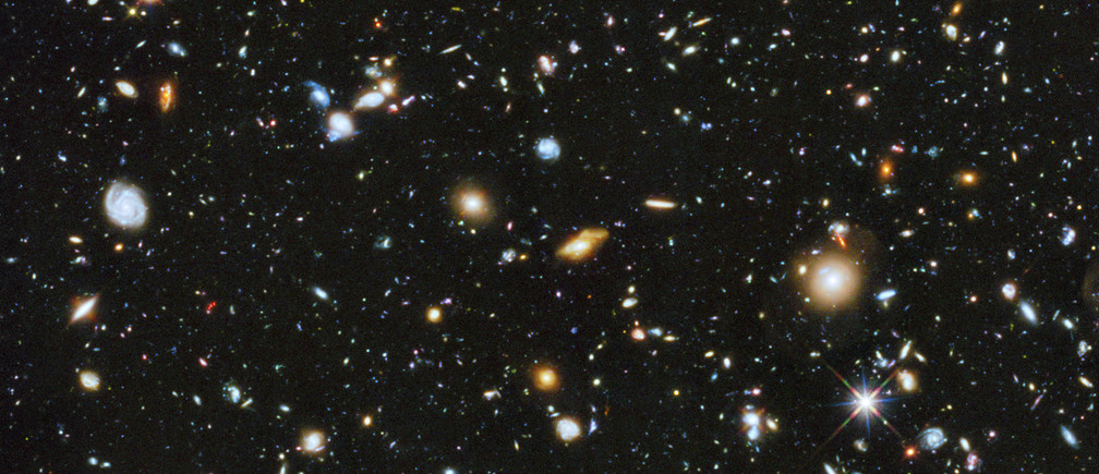 A composite of separate exposures taken in 2003 to 2012 with Hubble's Advanced Camera for Surveys and Wide Field Camera 3 of the evolving universe is shown in this handout photo provided by NASA, June 3, 2014.  Researchers say the image, from a new study called the Ultraviolet Coverage of the Hubble Ultra Deep Field, provides the missing link in star formation. Made from 841 orbits of telescope viewing time, it contains approximately 10, 000 galaxies, extending back in time to within a few hundred million years of the big bang, according to NASA.  REUTERS/HUDF/NASA/Handout via Reuters   (OUTERSPACE - Tags: SCIENCE TECHNOLOGY) ATTENTION EDITORS - FOR EDITORIAL USE ONLY. NOT FOR SALE FOR MARKETING OR ADVERTISING CAMPAIGNS. THIS IMAGE HAS BEEN SUPPLIED BY A THIRD PARTY. IT IS DISTRIBUTED, EXACTLY AS RECEIVED BY REUTERS, AS A SERVICE TO CLIENTS - RTR3S21L