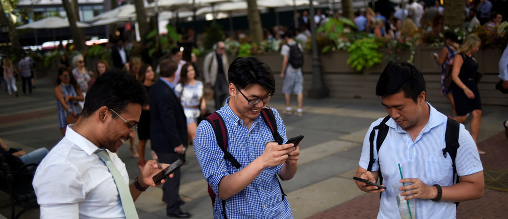 "People play the augmented reality mobile game ""Pokemon Go"" by Nintendo in Bryant Park, New York City, U.S. July 11, 2016."