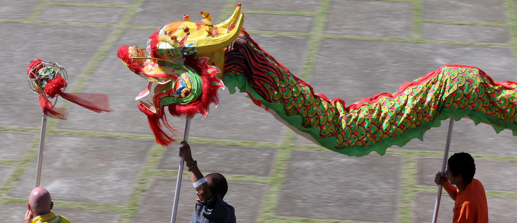 A fire dragon dance during Chinese Lunar New Year celebrations in Cotia, Brazil