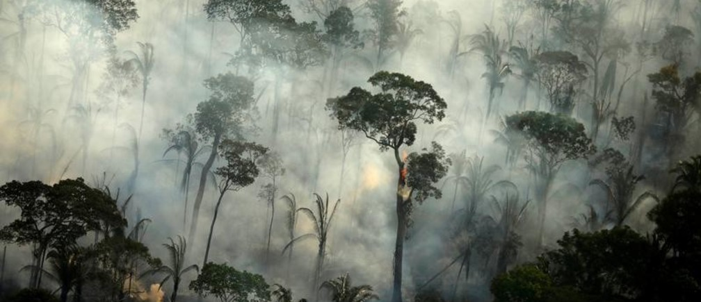 "Smoke billows from a fire in an area of the Amazon rainforest near Porto Velho, Rondonia State, Brazil, September 10, 2019. REUTERS/Bruno Kelly/File Photo SEARCH ""AMAZON POY"" FOR THIS STORY. SEARCH ""REUTERS POY"" FOR ALL BEST OF 2019 PACKAGES. TPX IMAGES OF THE DAY. - RC2JPD986XH4"