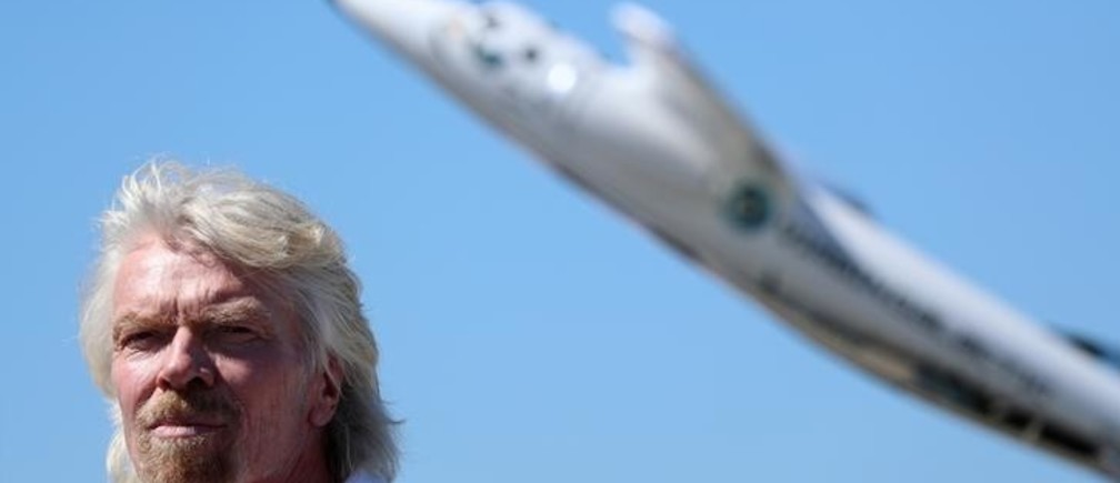 Richard Branson listens to speeches as he is inducted into the Flight Path Walk of Fame at Los Angeles Airport Flight Path Museum, highlighting his accomplishments in aviation and aerospace in Los Angeles, California, U.S. March 28, 2018. REUTERS/Mike Blake