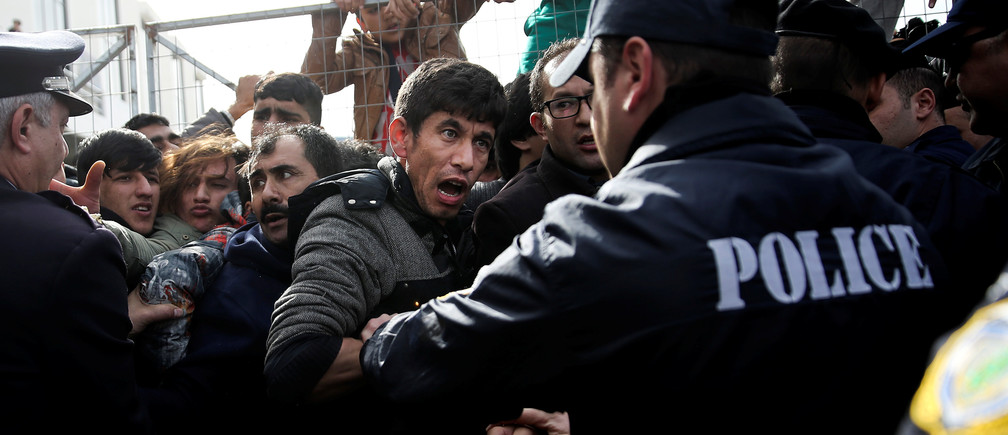 An Afghan migrant shouts at a police officer as refugees and migrants, most of them Afghans, argue with police as they block the entrance of the refugee camp at the disused Hellenikon airport, in Athens, Greece, February 6, 2017. REUTERS/Alkis Konstantinidis     TPX IMAGES OF THE DAY - RTX2ZTMW