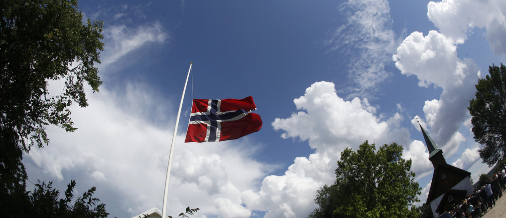 The Norwegian flag flies at half mast during the funeral ceremony for Bano Rashid, 18, at Nesodden church near Oslo July 29, 2011, as the nation pauses for memorial services after the worst attacks on the nation since World War Two. Norway is holding the first funeral on Friday for a victim of Anders Behring Breivik's massacre of 76 people a week ago amid signs of a leap in popularity for the ruling Labour Party that was his main target. Flags around the nation flew at half mast to mark a day of memorial one week after Breivik, an anti-Islam zealot, set off a bomb in central Oslo that killed 8 people. He then shot 68 people at a summer camp for youths of the ruling Labour Party.