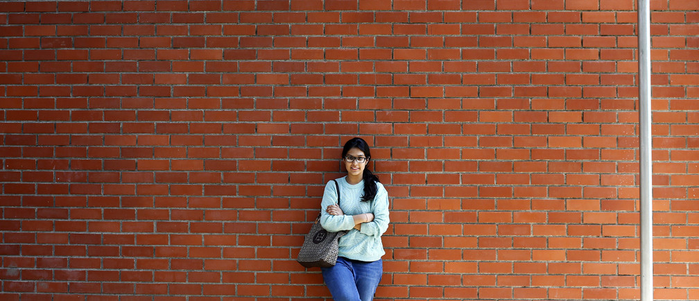 Urvashi Kapila, 19, a college student, poses for a picture at her college campus in New Delhi March 7, 2014. Urvashi, who will be voting for the first time in the upcoming general elections, said the elections will witness the largest youth participation to date and will herald a new kind of politics which she hopes would be a more transparent government. She is among more than 100 million registered new voters, who will cast their ballots when the world's biggest democracy holds a general election that will run from April 7 to May 12. Picture taken March 7, 2014. REUTERS/Anindito Mukherjee (INDIA - Tags: ELECTIONS POLITICS EDUCATION) - GM1EA3S0DYR01