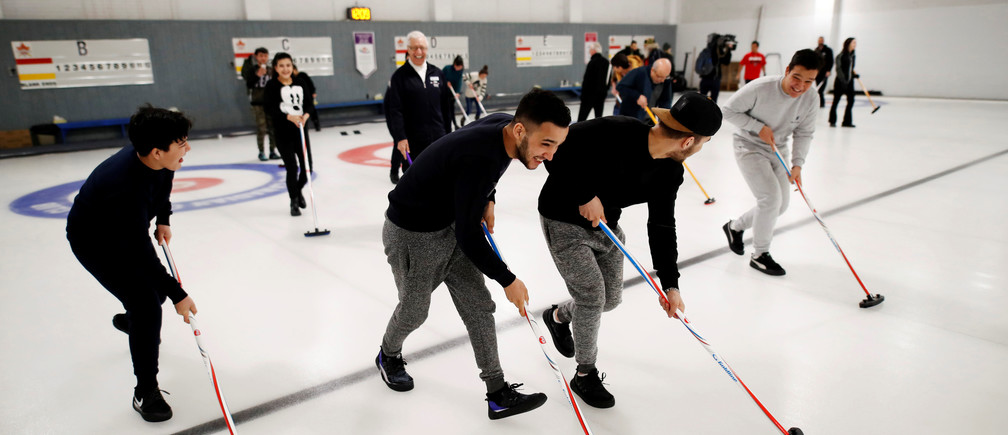 A refugee family from Afghanistan resettled in Canada are introduced to the sport of curling