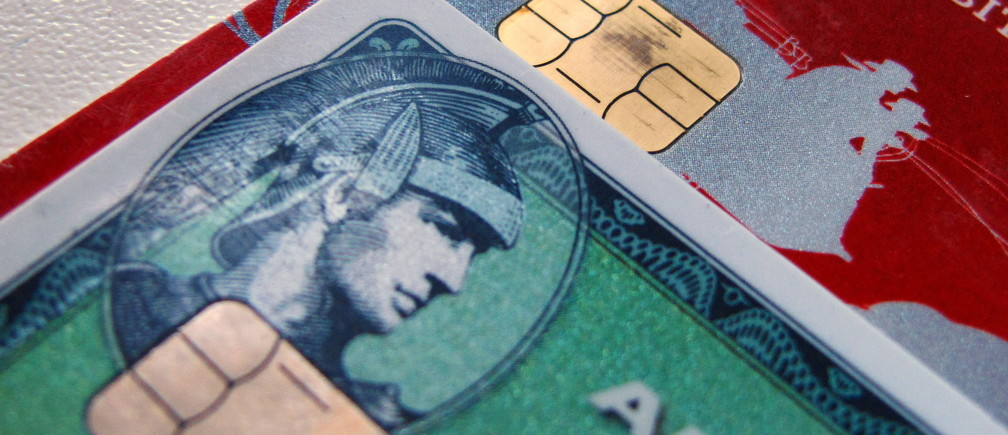 Computer chips are seen on newly-issued credit cards in this photo illustration taken in Encinitas, California September 28, 2015. In an effort to reduce counterfeit and credit card fraud more than 200 million payment cards have been issued with embedded computer chips in the U.S., ahead of a Oct. 1 deadline for the switch to such cards, according to the Smart Card Alliance. Credit card companies have set the October deadline which will require U.S. consumers to carry a new kind of card and retailers across the nation to upgrade payment terminals.  REUTERS/Mike Blake - GF10000225781