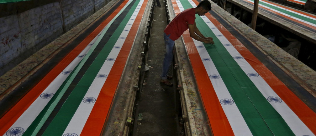 Workers make Indian national flags inside a textile printing workshop ahead of the Independence Day celebrations in Ahmedabad, India.
