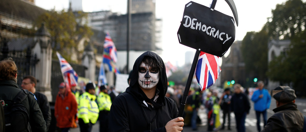 A protester poses for a picture outside the Parliament in Westminster, London, Britain October 31, 2019.