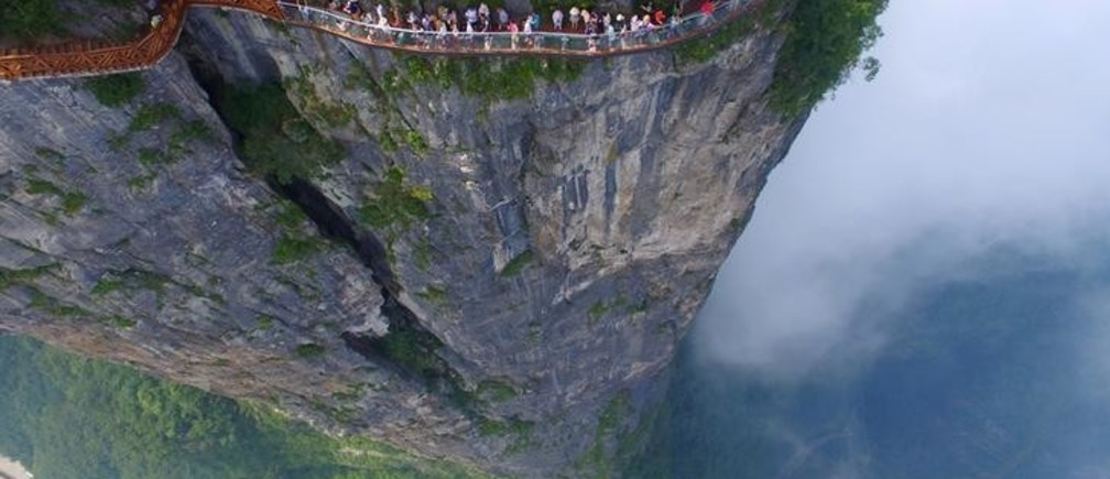 Tourists explore a sightseeing platform in Zhangjiajie, Hunan Province, China, REUTERS/Stringer