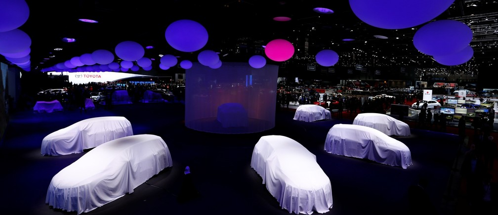 Covered cars are pictured at the stand of Renault at the 86th International Motor Show in Geneva, Switzerland, March 1, 2016.