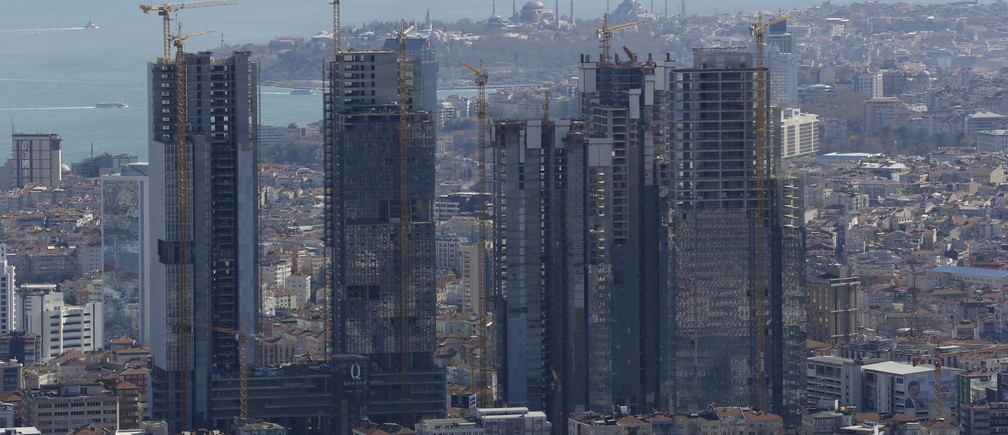 New skyscrapers under construction are pictured in Istanbul April 10, 2015. Turkish President Tayyip Erdogan dreams of transforming Istanbul into a financial hub that can rival Dubai or Singapore, but first he needs to win over would-be investors. Market participants say interest from small investors is on the wane, thanks to higher fees and as new flotations fail to spark interest. That's bad news for an exchange that relies on retail investors for much of its liquidity. It also raises questions about the viability of the government's drive to make Istanbul a global top-10 financial hub. Picture taken April 10, 2015. REUTERS/Murad Sezer - GF10000054907