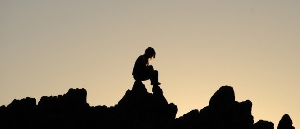A girl sits on rocks during the summer solstice at the Kokino megalithic observatory, June 20, 2012. The 3,800-year-old observatory was discovered in 2001 in the northwestern town of Kumanovo, 70 km (43 miles) north from Skopje, and is ranked as the fourth oldest observatory in the world, according to NASA. REUTERS/Ognen Teofilovski