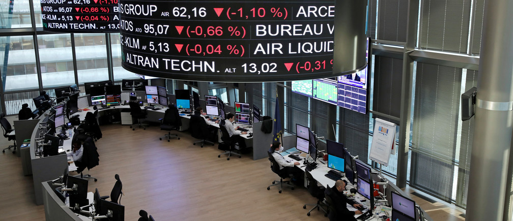 Company stock price information for LVMH Moet Hennessy Louis Vuitton SA, is displayed on screens as they hang above the Paris stock exchange, operated by Euronext NV, in La Defense business district in Paris, France, December 14, 2016. REUTERS/Benoit Tessier - RTX2V13L