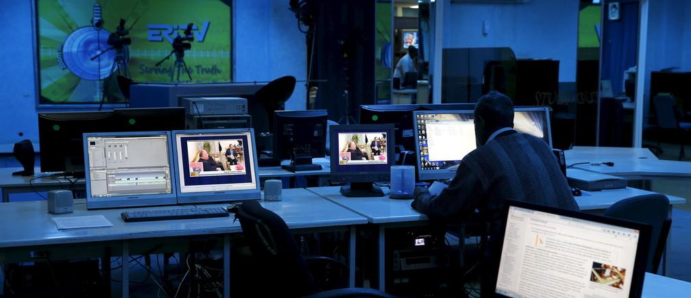 Journalists work inside their Eritrea Television newsroom in the capital Asmara, February 20, 2016.