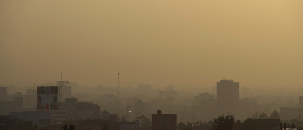 Mexico City is seen through heavy smog in the early morning March 30, 2011. According to the IMECA (atmospheric monitoring system of Mexico City), pollution levels have reached a level of 107, considered as bad, on the IMECA index in the northeast of the capital. The IMECA is a real time system to monitor the level of pollution and risks to the human health.