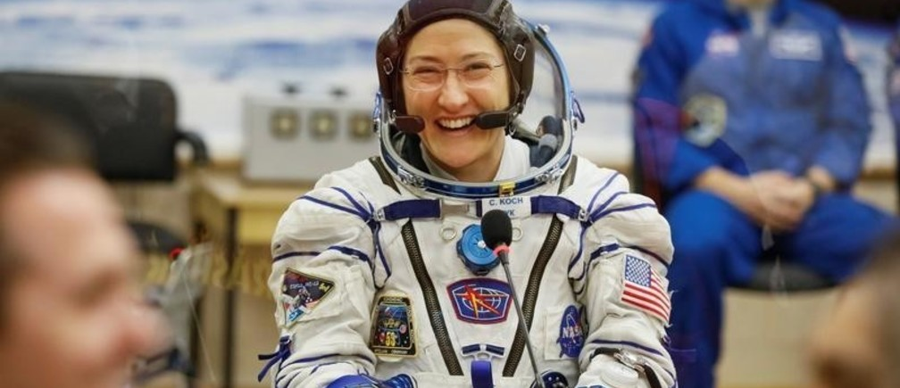 The International Space Station (ISS) crew member Christina Koch of the U.S. smiles after donning space suit check shortly before launch at the Baikonur Cosmodrome, Kazakhstan March 14, 2019.  REUTERS/Shamil Zhumatov - RC17AE9D01A0