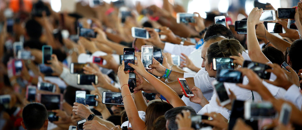 "The faithful use mobile phones as Pope Francis arrives at the National Reconciliation Encounter at ""Las Malocas Park"" in Villavicencio, Colombia September 8, 2017."