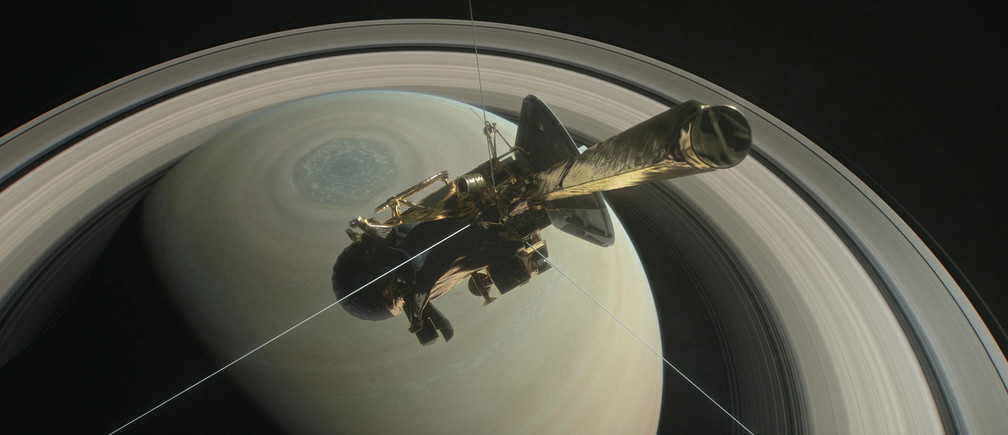 The spacecraft Cassini is pictured above Saturn's northern hemisphere prior to making one of its Grand Finale dives in this NASA handout illustration obtained by Reuters August 29, 2017.   NASA/Handout via REUTERS  ATTENTION EDITORS - THIS IMAGE WAS PROVIDED BY A THIRD PARTY. - RC18585AC9D0