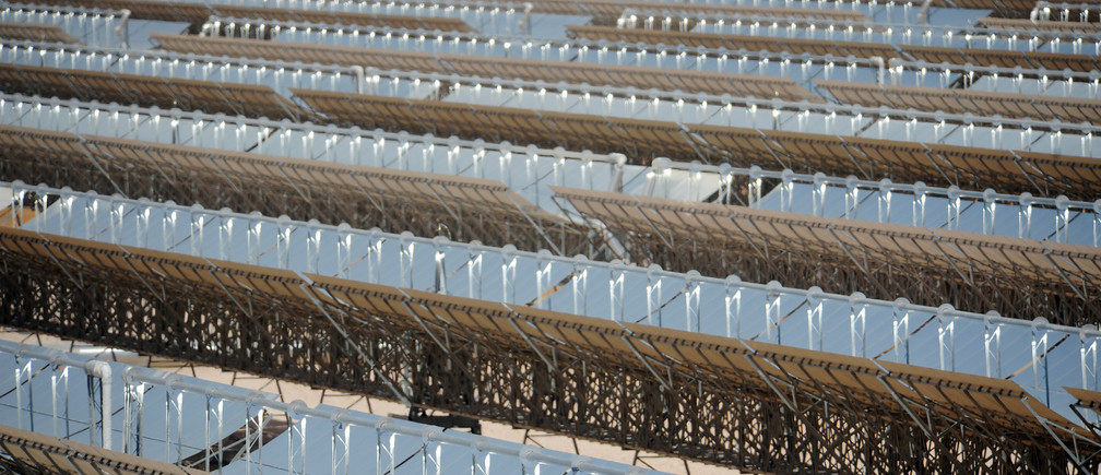 A section of solar power plant Shams 1 is seen during the official inauguration, at Madinat Zayed in Abu Dhabi March 17, 2013. The largest renewable energy project in the Middle East, Shams 1, covers 2.5 square kilometres in Madinat Zayed in the Western Region, and will generate 100 megawatts of clean and sustainable energy - enough to power 20,000 homes, and the biggest step so far towards Abu Dhabi's goal of obtaining 7 percent of its energy from renewable sources by 2020, according to local media. REUTERS/Ben Job (UNITED ARAB EMIRATES - Tags: ENVIRONMENT ENERGY BUSINESS) - GM1E93H1IQM01