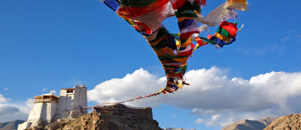 "Prayer flags fly at Namgyal Tsemo Monastery above the town of Leh in Ladakh, India September 24, 2016. REUTERS/Cathal McNaughton        SEARCH ""CHILD MONK"" FOR THIS STORY. SEARCH ""WIDER IMAGE"" FOR ALL STORIES. - RTX2XMM3"