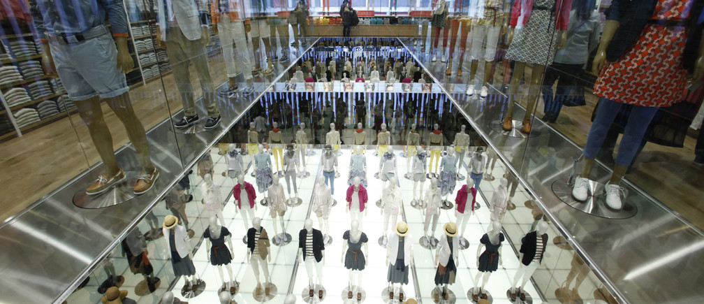 Mannequins are displayed at Fast Retailing's new flagship Uniqlo store at Tokyo's Ginza district March 16, 2012.
