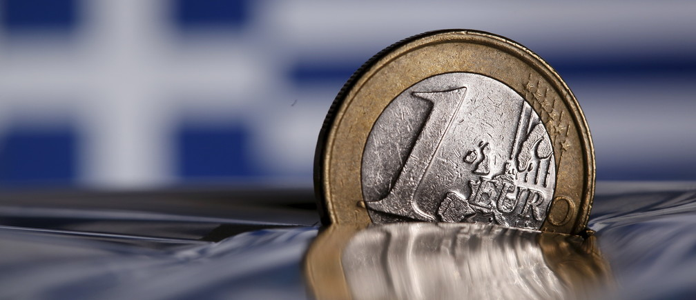 A one Euro coin is seen in this picture illustration taken in Rome, Italy July 9, 2015. The European Union's chairman joined growing international calls for Greece to be granted debt restructuring as part of any new loan deal if it delivers convincing reforms to avert imminent bankruptcy. REUTERS/Tony Gentile - GF10000153827