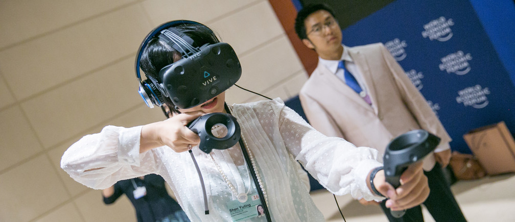 Participants experiencing Virtual Reality at the World Economic Forum - Annual Meeting of the New Champions in Tianjin, People's Republic of China 2016.