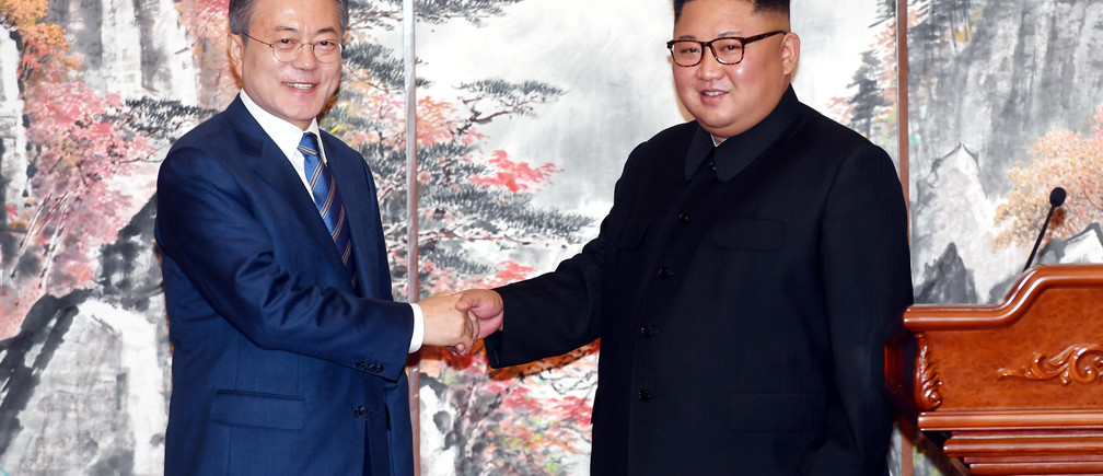 South Korean President Moon Jae-in shakes hands with North Korean leader Kim Jong Un during a joint news conference in Pyongyang, North Korea, September 19, 2018. Pyeongyang Press Corps/Pool via REUTERS - RC18A51D5B60
