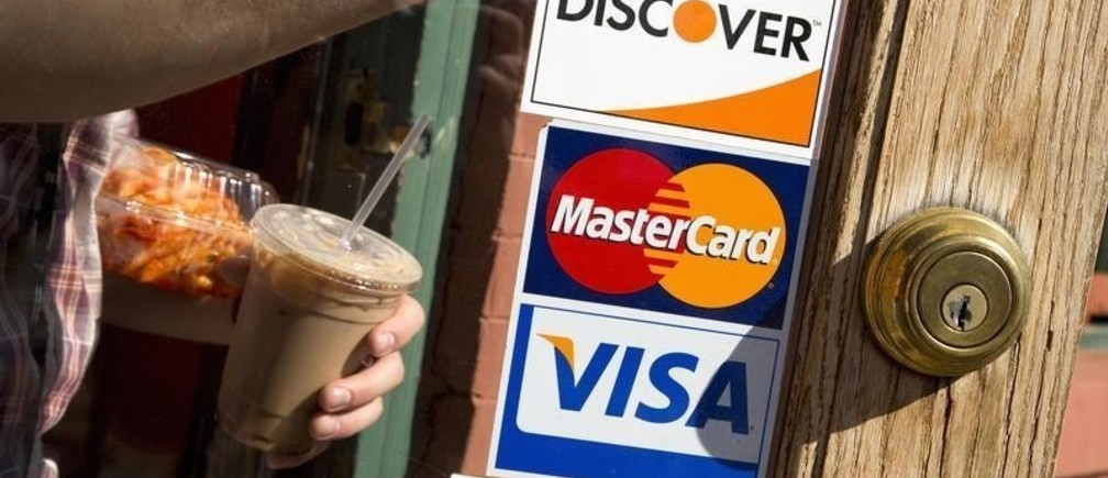 A coffee shop displays signs for Visa, MasterCard and Discover, in Washington, May 1, 2013. This logo has been updated and is no longer in use.  REUTERS/Jonathan Ernst    (UNITED STATES - Tags: BUSINESS) - GM1E9520E0O01