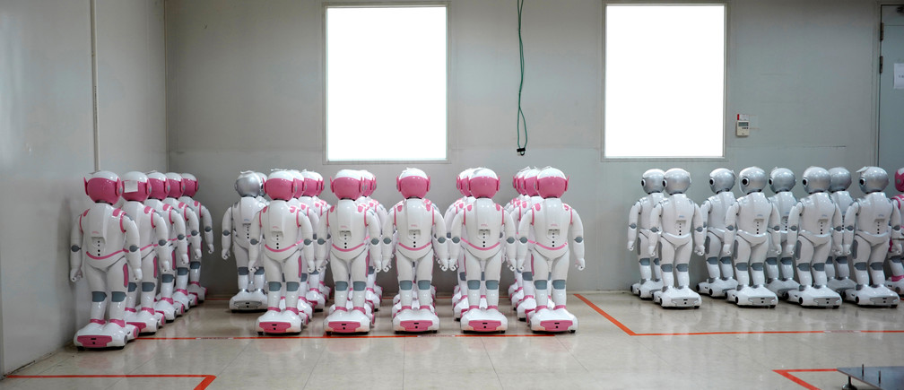 iPal social robots, designed by AvatarMind, are seen at an assembly plant in Suzhou, Jiangsu province, China July 4, 2018. Designed to offer education, care and companionship to children and the elderly, the 3.5-feet tall humanoid robots come in two genders and can tell stories, take photos and deliver educational or promotional content. Picture taken July 4, 2018. REUTERS/Aly Song - RC1E55FB7F00